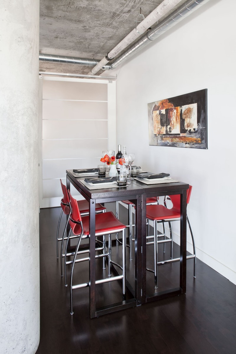 Bar height table with red stools